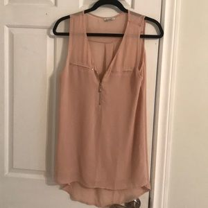 Nude tank, excellent condition with silver zip.